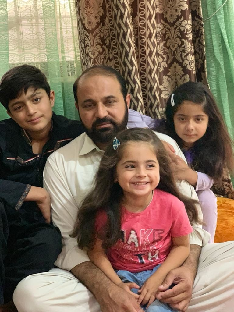 Aaira with her father and siblings